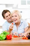 Couple preparing breakfast Royalty Free Stock Photos