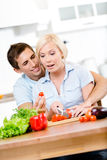 Couple preparing breakfast together Stock Photography