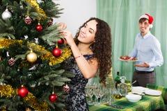Couple preparing for celebrating Christmas Royalty Free Stock Photos