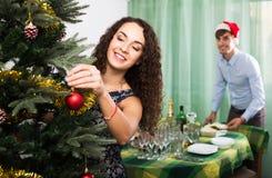 Couple preparing for celebrating Christmas Stock Photos