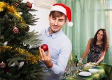 Couple preparing for celebrating Christmas Stock Image
