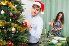 Couple preparing for Christmas together Royalty Free Stock Photo