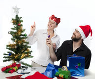 Couple preparing Christmas tree Royalty Free Stock Photography
