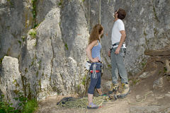 Couple preparing for climbing Stock Image