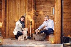 Couple preparing firewood Stock Photo