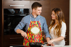 Couple preparing food in the the kitchen Royalty Free Stock Photography