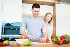 Couple preparing food Stock Photos