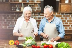 Couple preparing food together stock photo