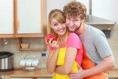 Couple preparing fresh vegetables food salad Royalty Free Stock Image