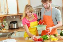 Couple preparing fresh vegetables food salad stock photos