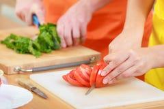 Couple preparing fresh vegetables food salad Stock Photography