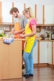 Couple preparing fresh vegetables salad. Diet Stock Image