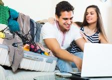 Couple preparing for honeymoon Stock Image