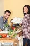 Couple preparing a meal Stock Photos