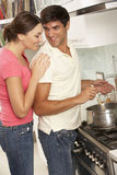 Couple Preparing Meal At Cooker Stock Images