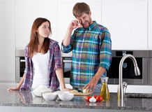 Couple preparing onion for pizza Royalty Free Stock Photos