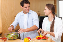 Couple preparing a salad Royalty Free Stock Photography