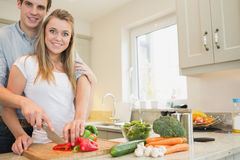 Couple preparing a salad Stock Photos