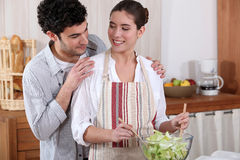 Couple preparing a salad Royalty Free Stock Photo
