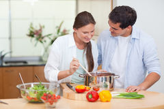 Couple preparing a sauce Royalty Free Stock Photo