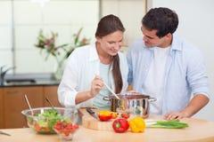 Couple preparing a sauce Royalty Free Stock Photo