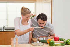 Couple preparing a sauce Royalty Free Stock Image