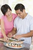 couple preparing sushi together στοκ εικόνες με δικαίωμα ελεύθερης χρήσης