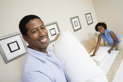 Couple Preparing Their Bed Stock Images