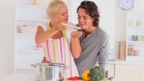 Couple preparing their dinner stock video footage