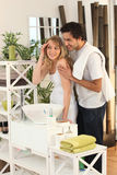 Couple preparing themselves in bathroom Royalty Free Stock Images