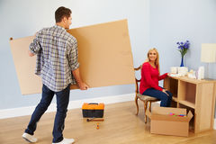 Couple Preparing To Assemble Flat Pack Furniture In Nursery Stock Image