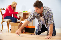 Couple Preparing To Assemble Flat Pack Furniture In Nursery Royalty Free Stock Photo
