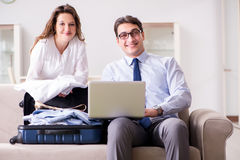 The couple preparing for the travel trip. Couple preparing for the travel trip Royalty Free Stock Photography