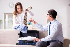 The couple preparing for the travel trip. Couple preparing for the travel trip Stock Image