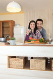 Couple preparing vegetables Royalty Free Stock Images