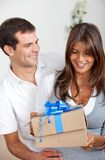 Couple with a present Royalty Free Stock Images