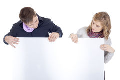 Couple with a presentation paper. Posing in studio Stock Photos