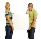 Couple presenting ad Royalty Free Stock Photography