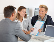Couple presenting project to banker Stock Photography