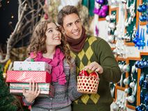 Couple With Presents Shopping In Store Stock Photo