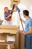 Couple pretending to fight at moving house Stock Images