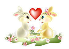 A couple of pretty cartoon rabbits Royalty Free Stock Photos