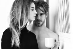 Couple of bearded man with cute sexy girl holding cup