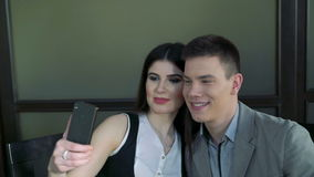 Couple,  pretty girl is  taking selfie in cafe stock video