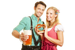 Couple with pretzel and beer at Royalty Free Stock Images
