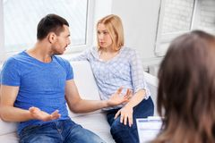 Couple with problem at family psychologist office royalty free stock photography
