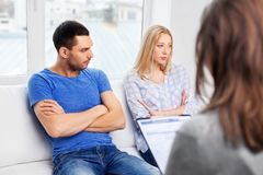 Couple with problem at family psychologist office stock image