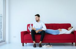 Couple with problem of foot odor and bad smell,Unpleasant snuff stink. Couple with problem of foots odor and bad smell,Unpleasant snuff stink royalty free stock image