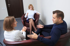Couple with problem on reception for family Stock Images