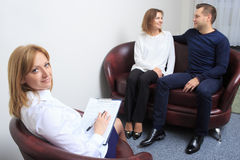 Couple with problem on reception for family Stock Image